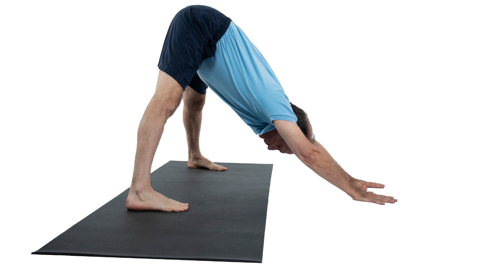 man practicing yoga downward facing dog with wide legs