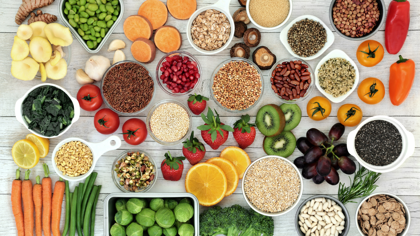 Fresh superfood concept with fruit, vegetables, grains, cereals, pulses, seeds, herbs and spice