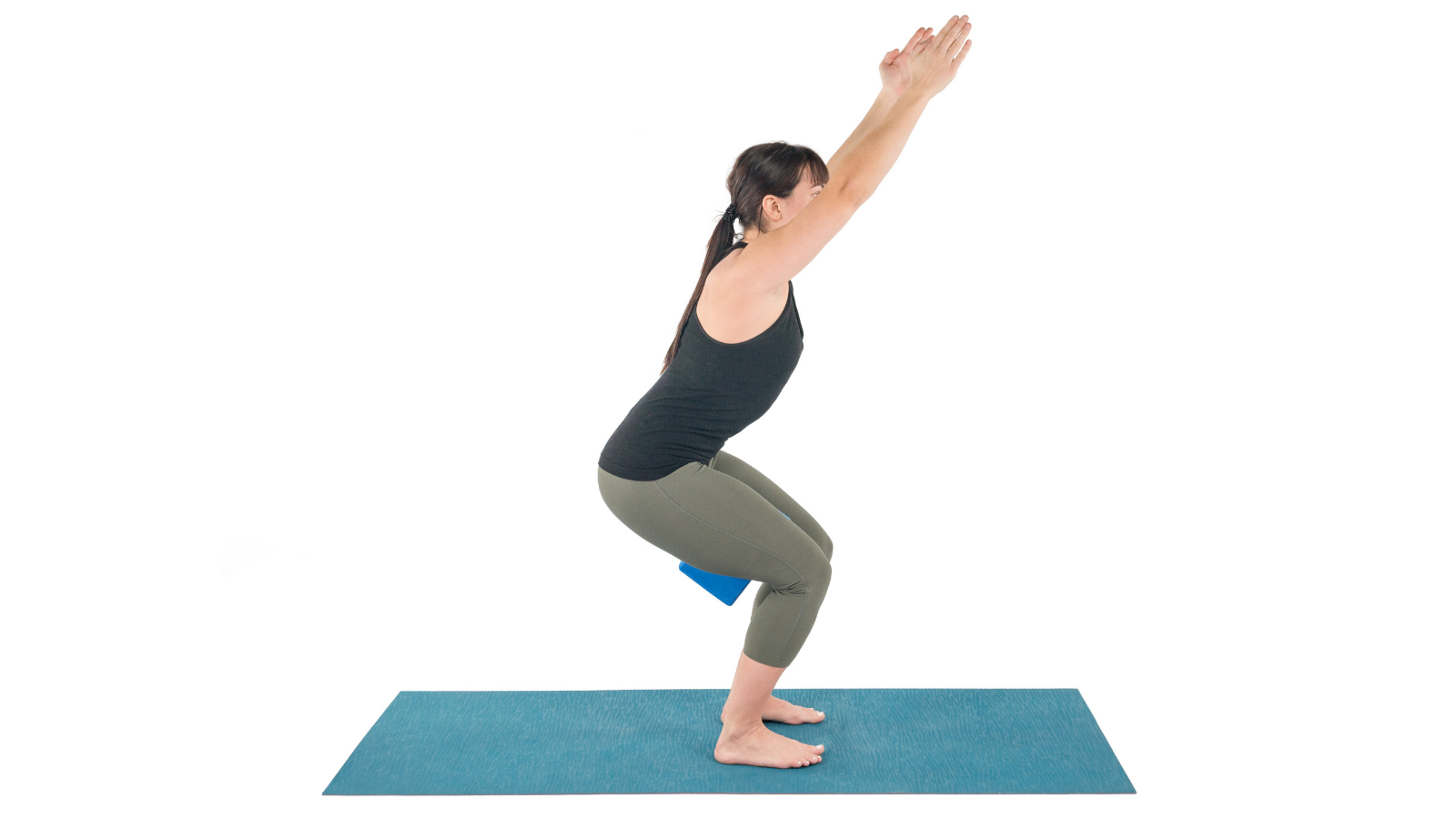 Chair Pose or Utkatasana with a block between the legs for greater strength and stability and pelvic floor health