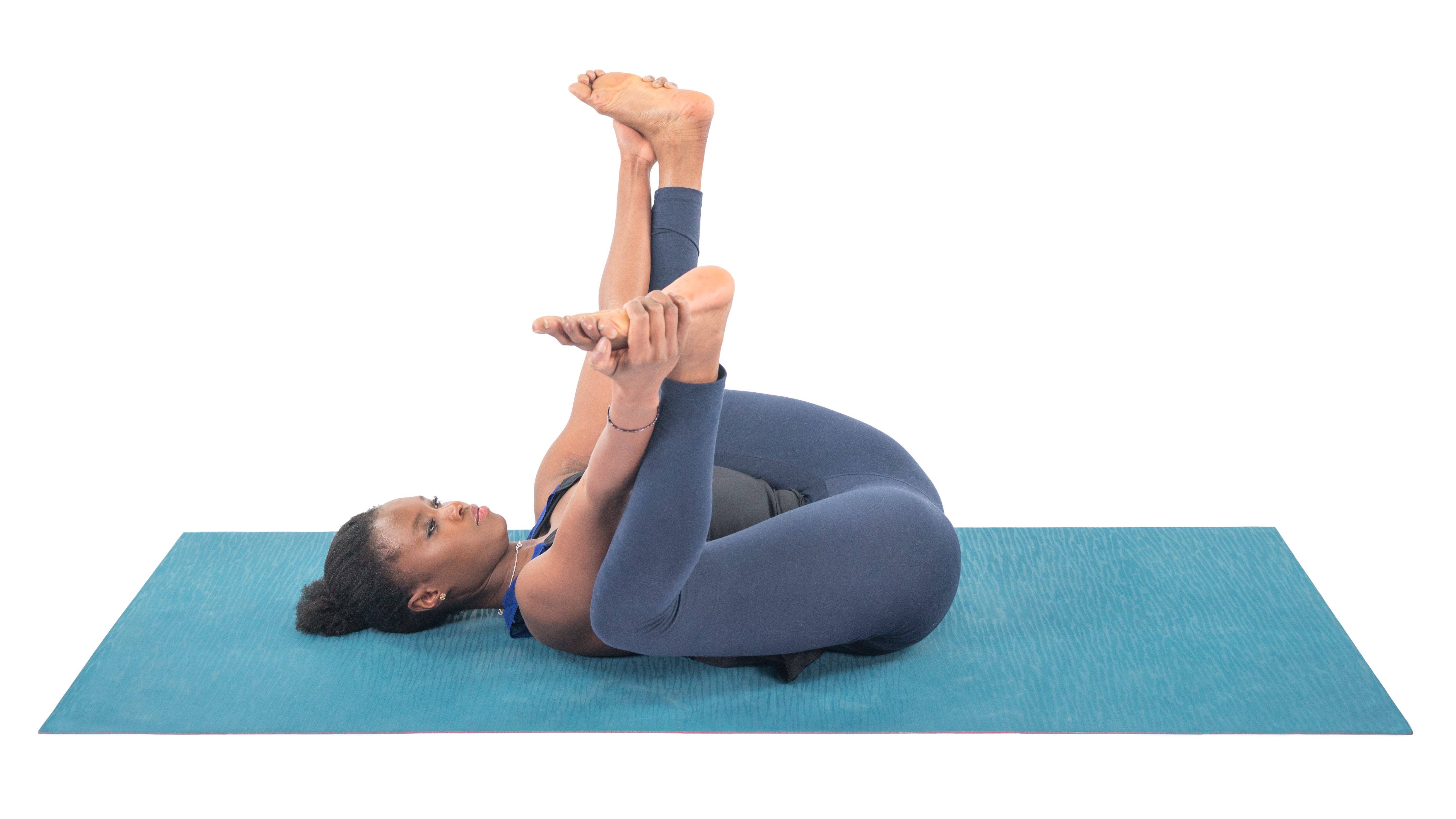 Ananda Balasana, Happy Baby pose, winding down your practice pose, rest and restore pose, winding down from peak pose