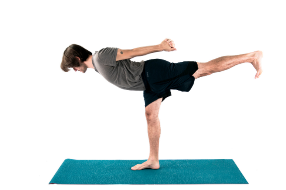Man practicing warrior 3 yoga pose