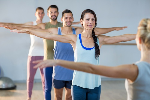 empowering group yoga practice of men and women
