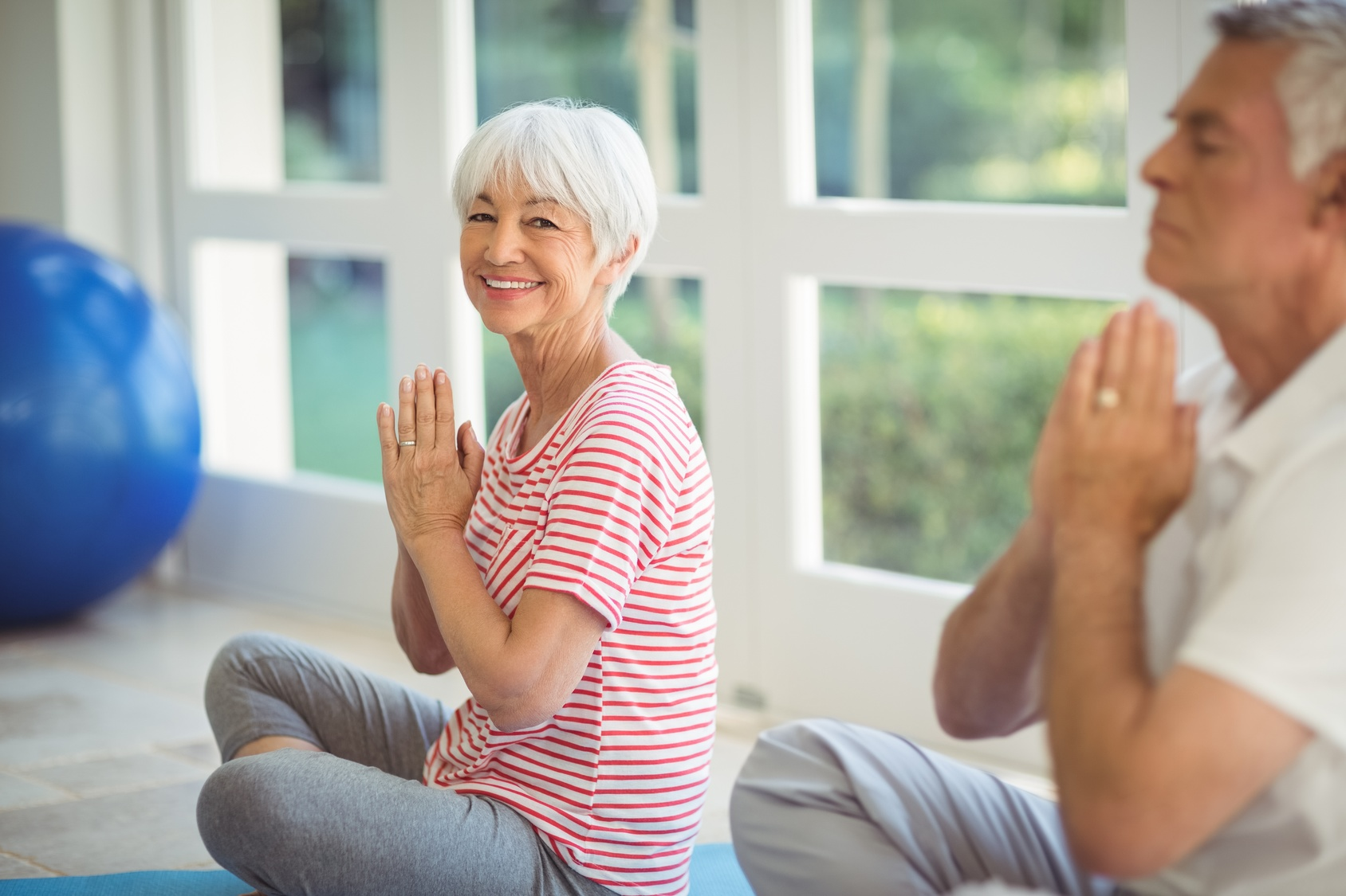 older woman practicing yoga for healthy posture