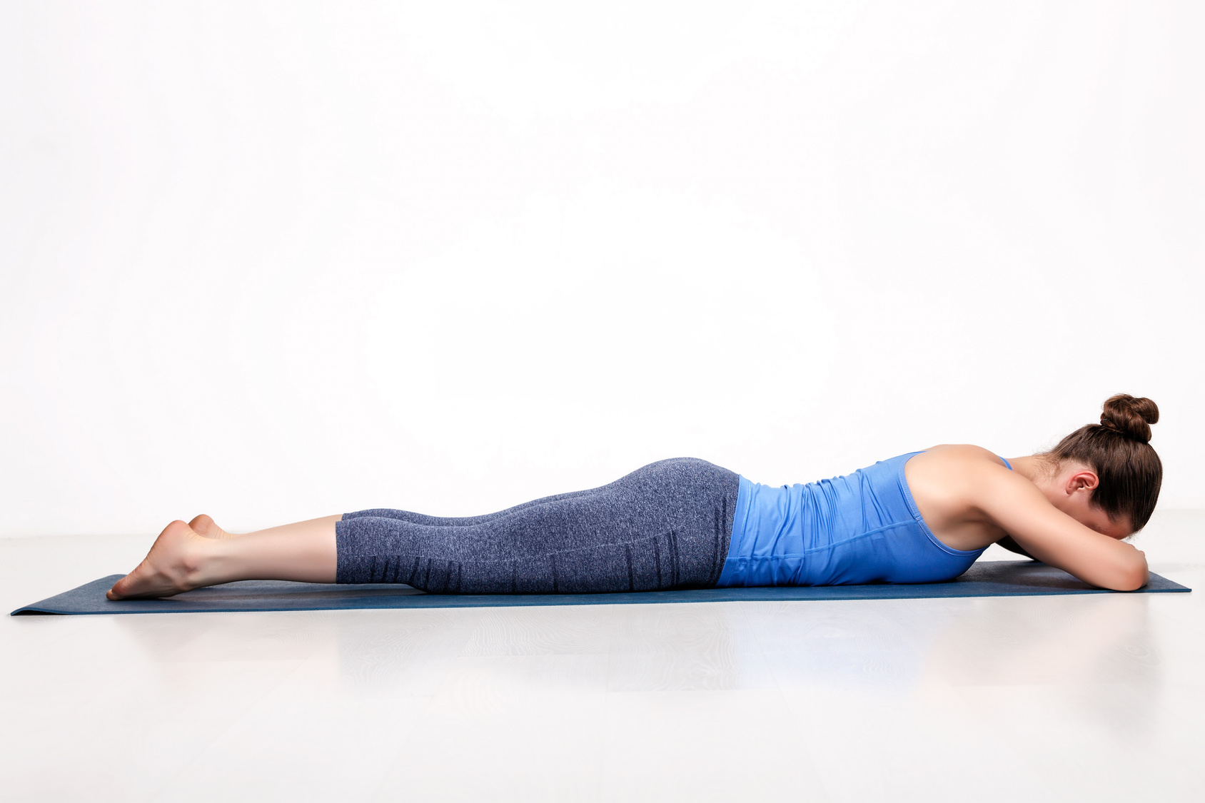 woman practicing shalabasana (locust pose) to strengthen the hip abductors