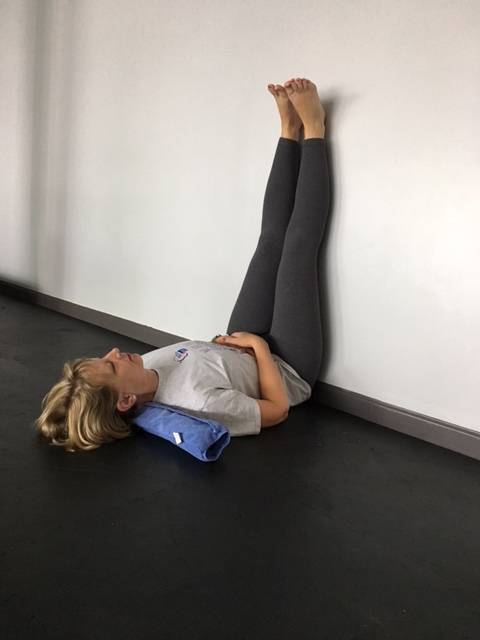 Legs up the Wall Pose with neck support