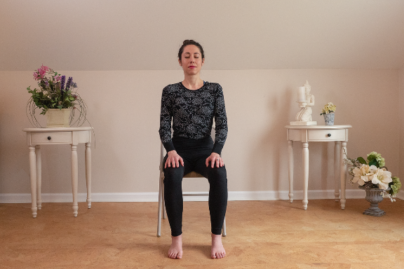 Woman practicing yoga meditation in chair