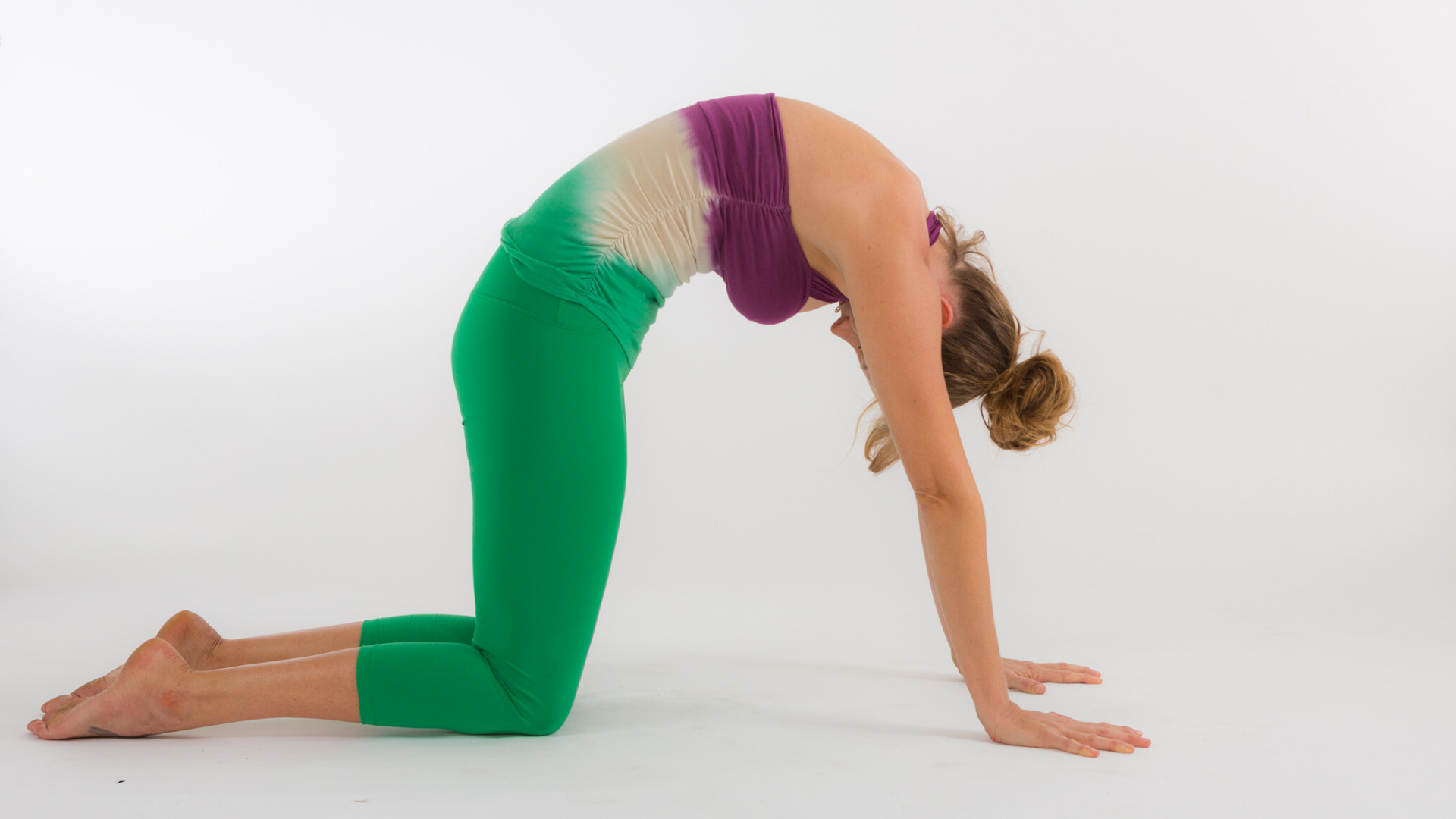Woman practicing cat-cow pose.
