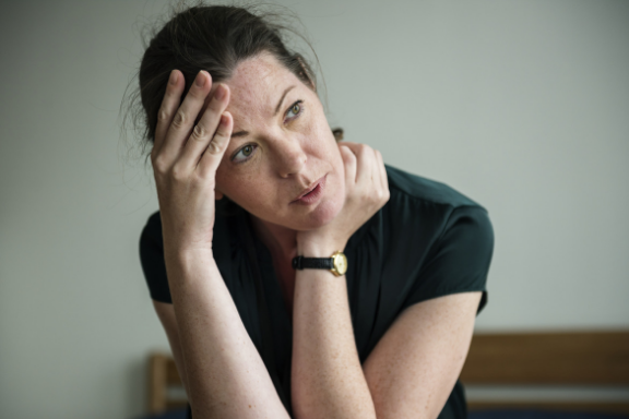 Woman looking tired and worn out