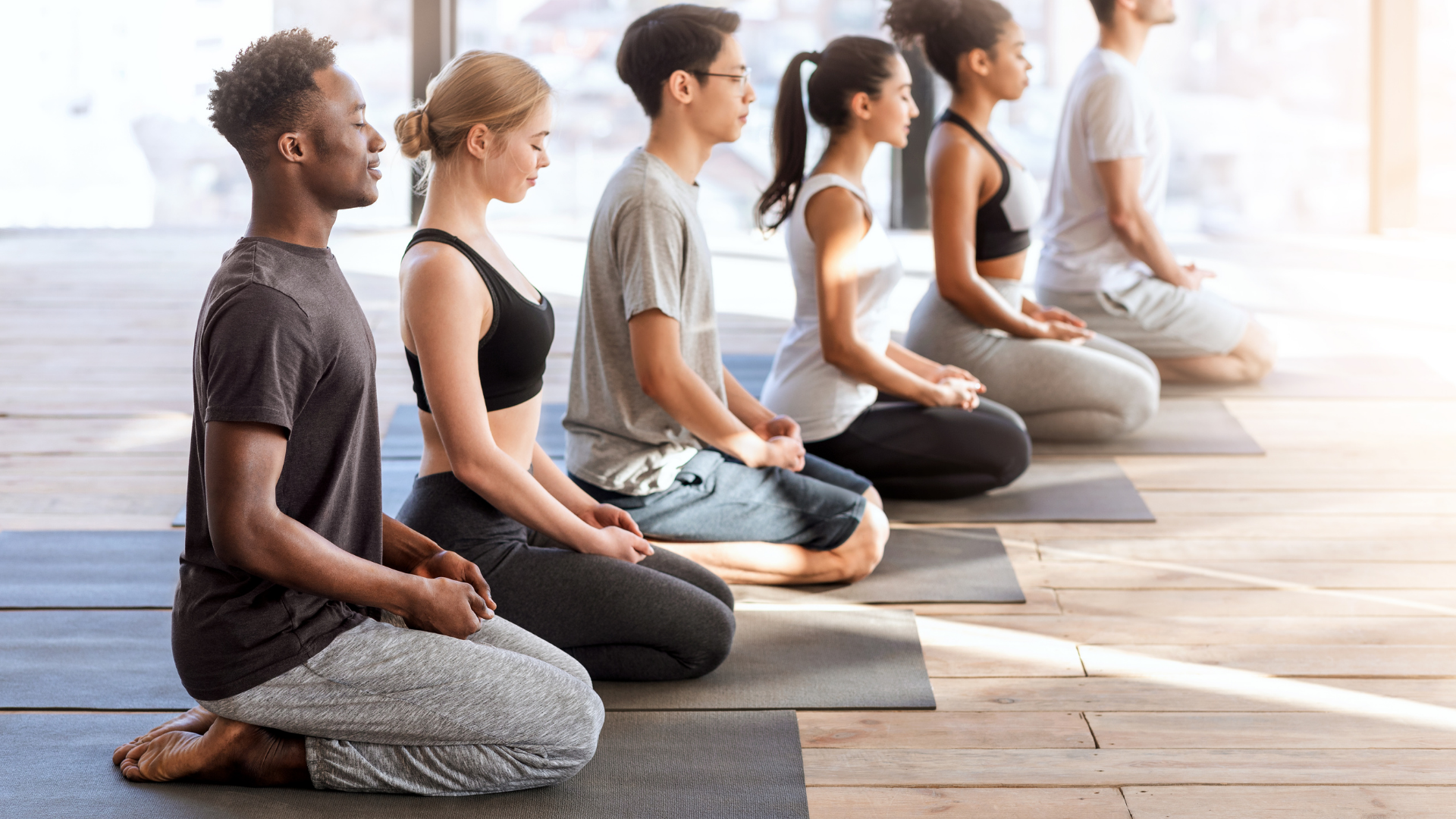 beginner_yoga_students_practicing_yoga_for_stress_reduction