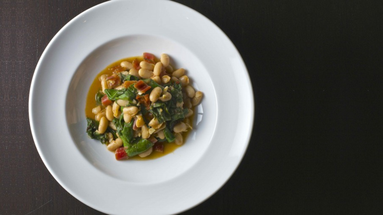Warm and delicious healthy recipe for chard and white bean ragout perfect for cold winter nights