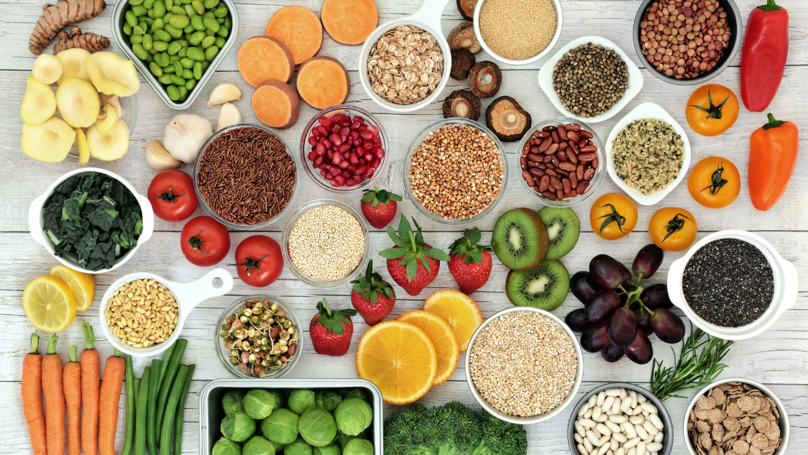 Fresh superfood concept with fruit, vegetables, grains, cereals, pulses, seeds, herbs and spice for a plant-based diet. Foods high in fiber, antioxidants, smart carbs, minerals and vitamins.