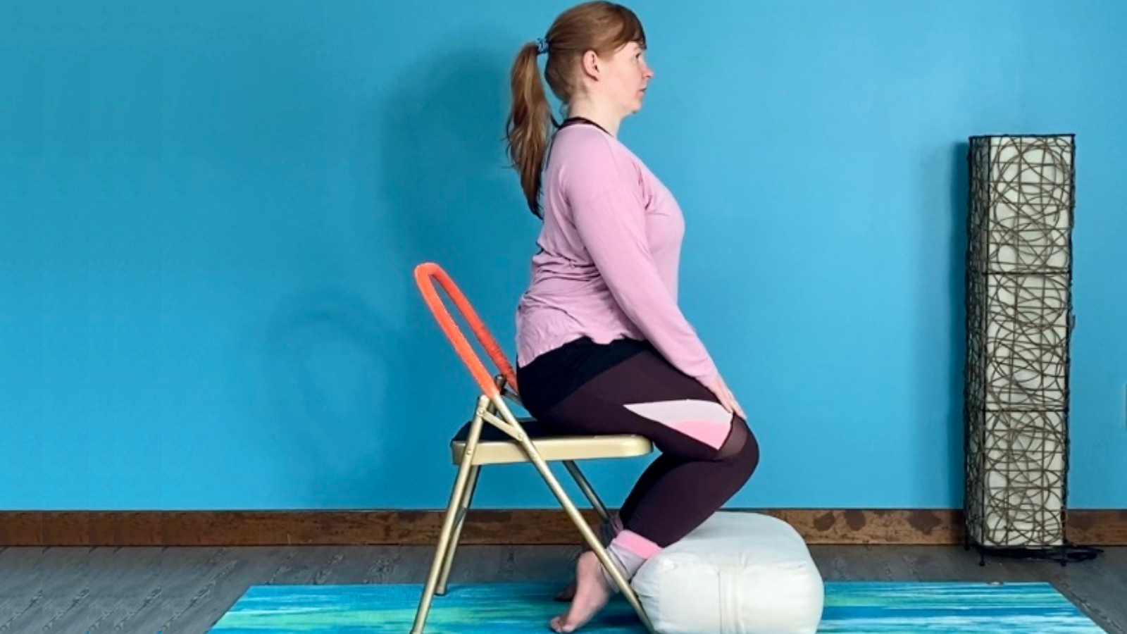 How to practice Hero Pose (Sanskrit name: Virasana) with a chair and bolster to help support the hips, knees, and ankles
