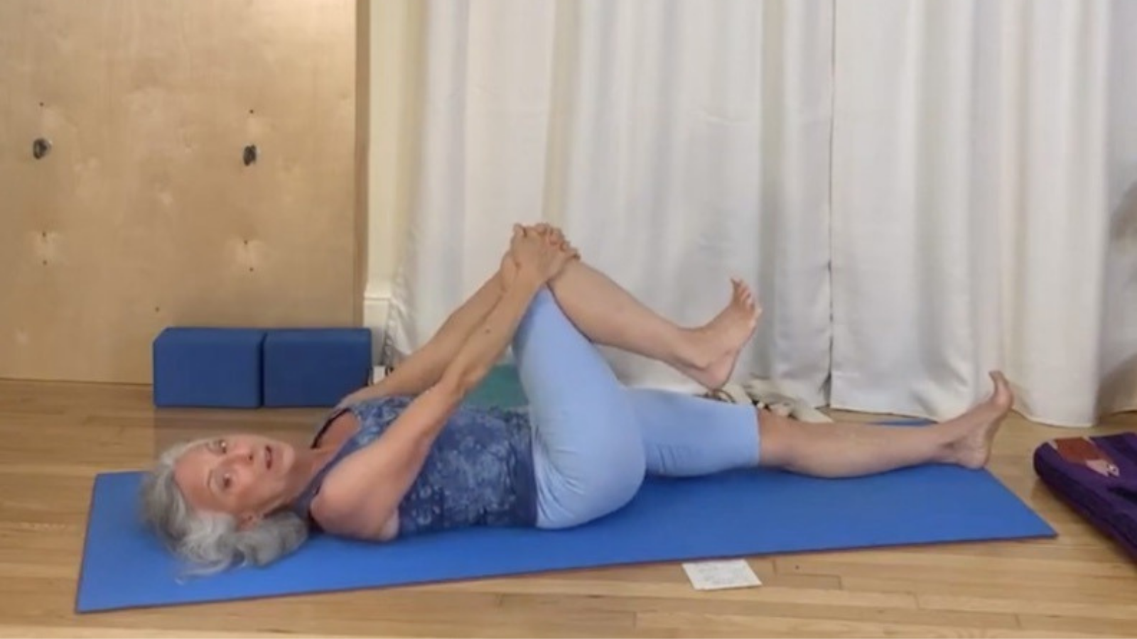 Yoga teacher practicing yoga that is healthy for the back