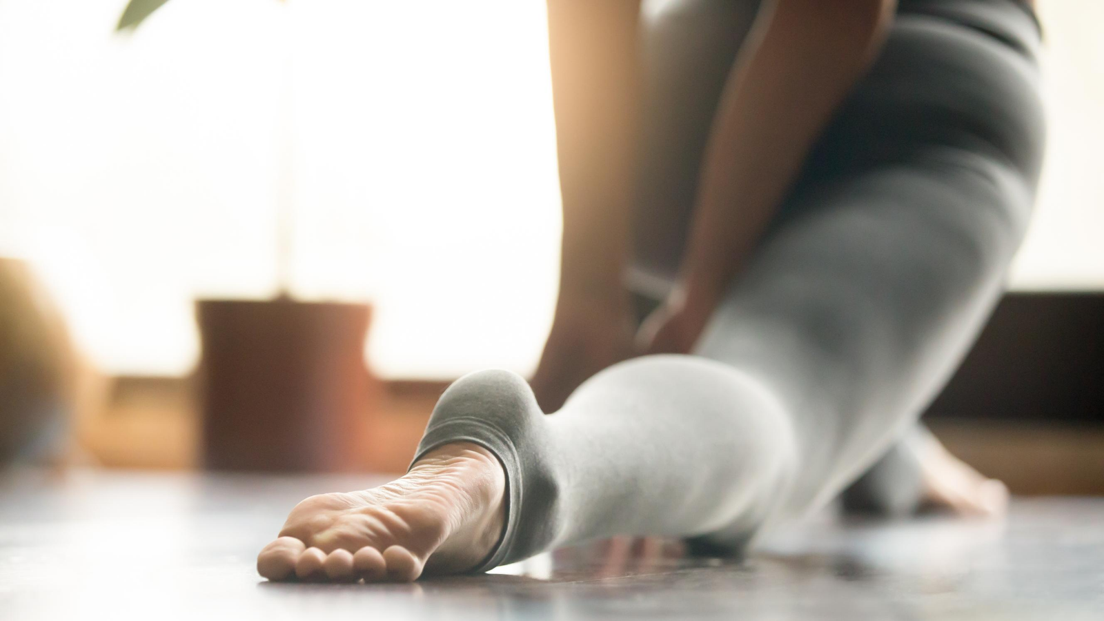 beginner yoga student learns how to practice yoga poses that relieve restless leg syndrome