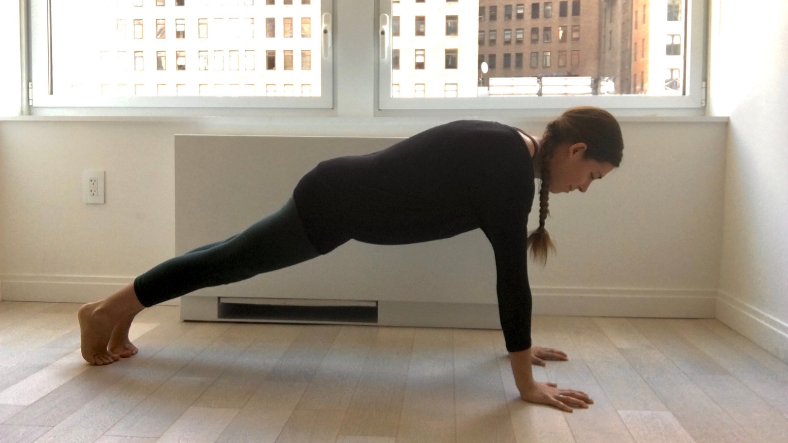 Yoga student practicing Plank Pose (Phalakasana) to strengthen and stabilize joints