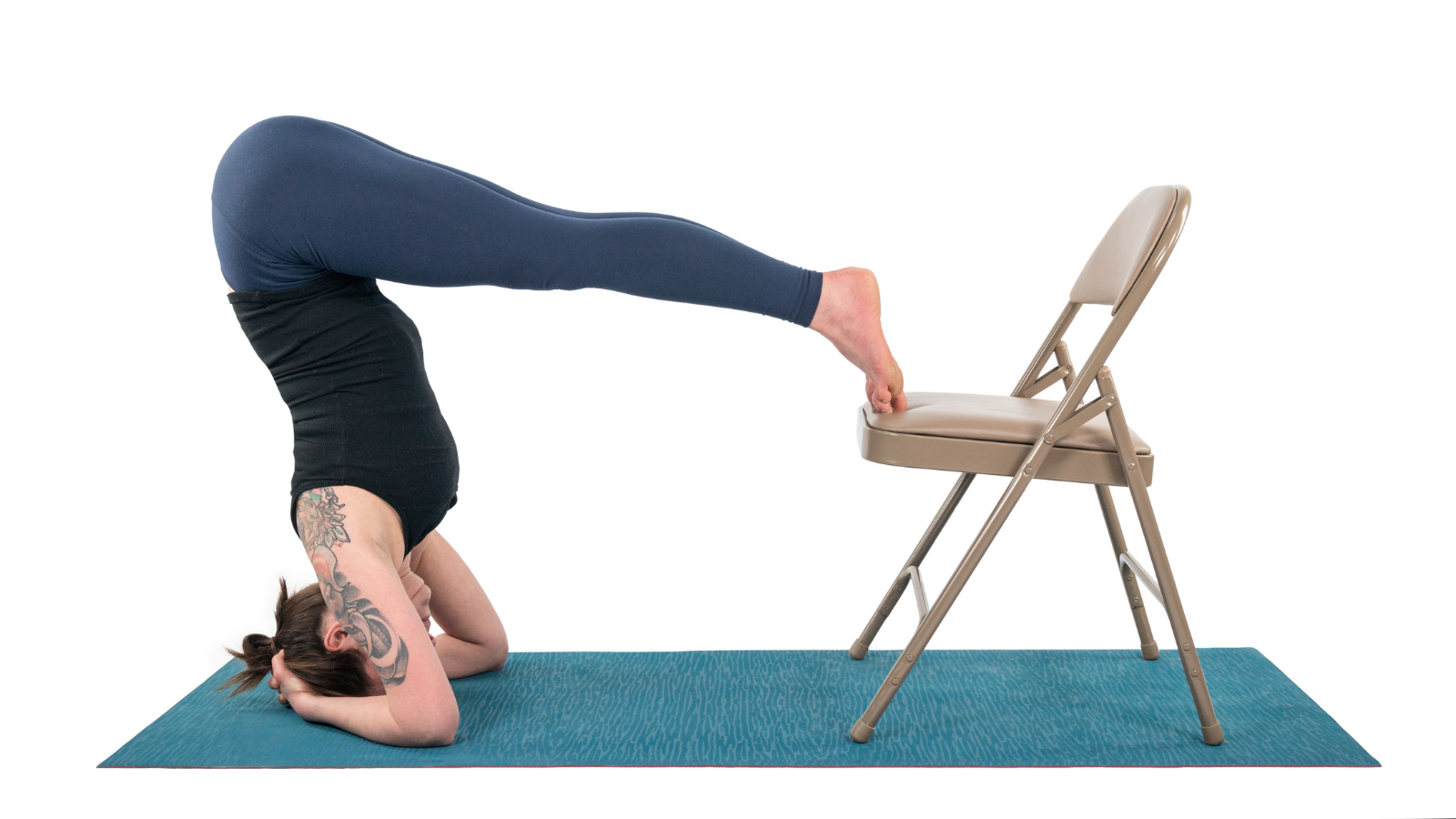 Yoga student practicing inversions Headstand Pose (Salamba Sirsasana) with a chair while menstruating