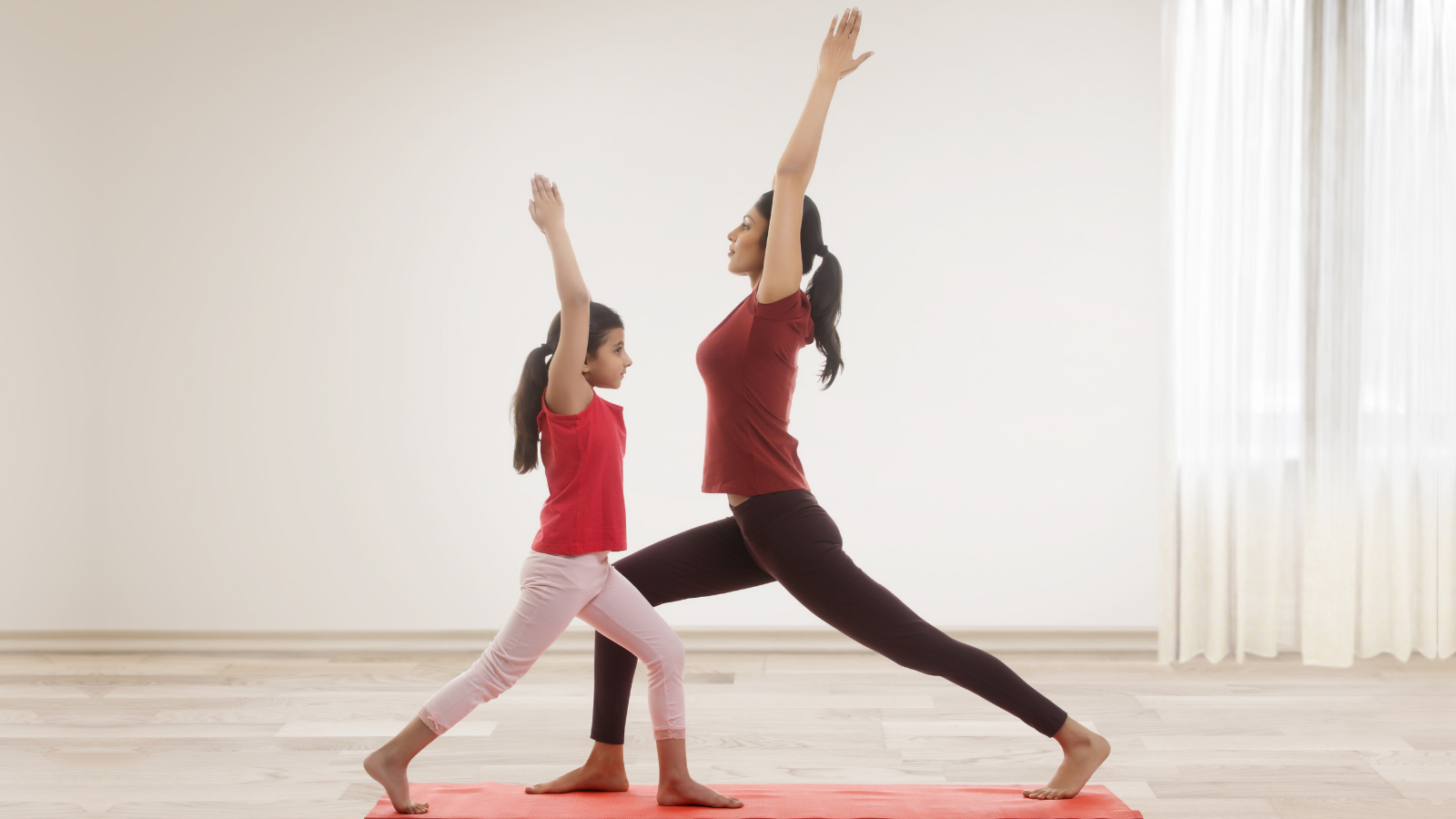 mother and daughter enjoying the benefits of yoga and exercise