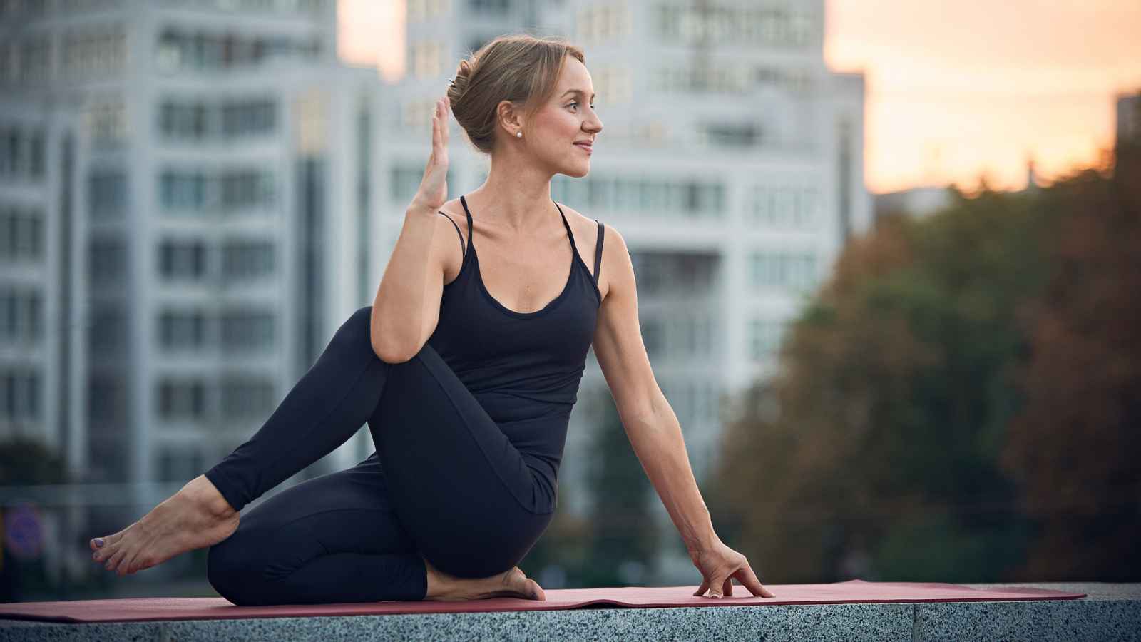 Yoga student practicing Half Lord of the Fishes Pose (Ardha Matsyendrasana) and the yogic principle of listening to your body