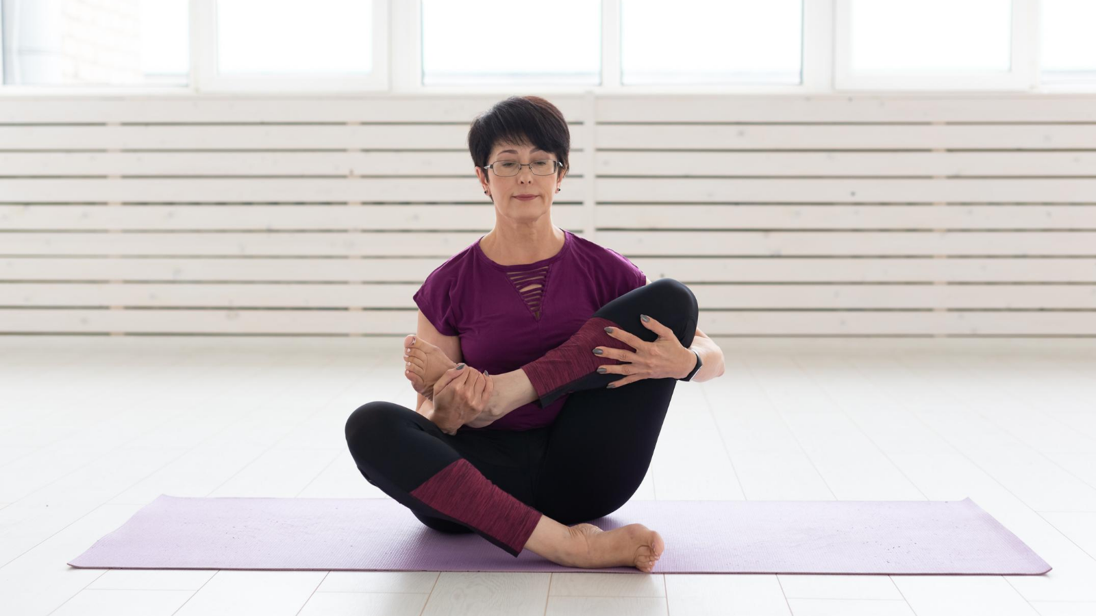 older beginner yoga student learns how to use yoga to reduce her symptoms of restless leg syndrome