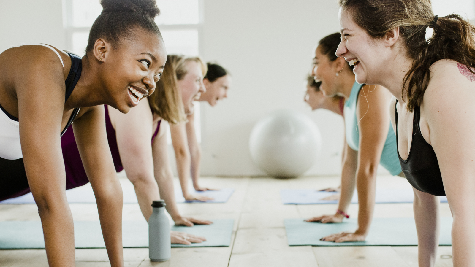 Group of cheerful women in yoga class and how that cheerfulness spreads more cheerfulness
