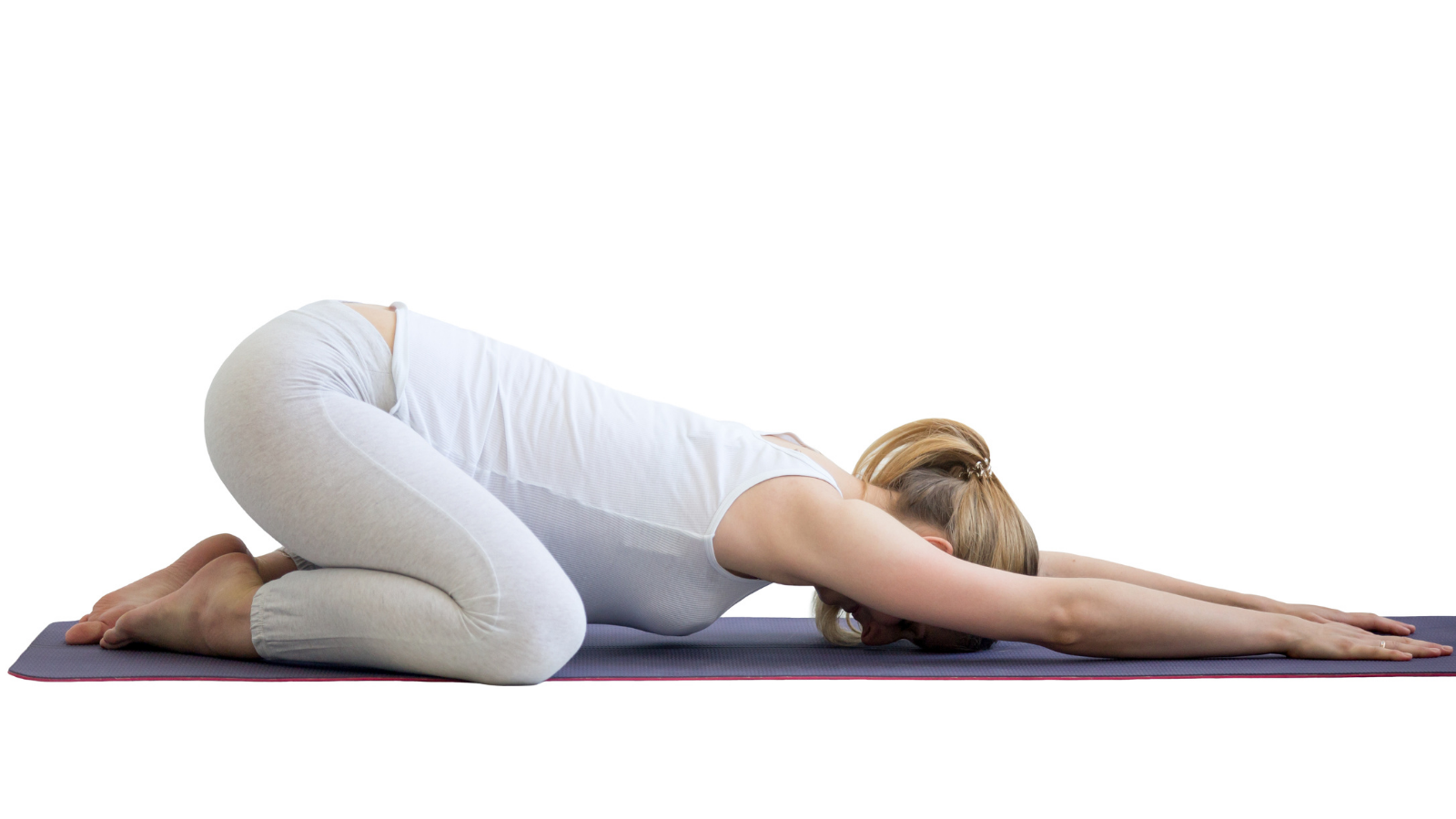 Yoga student practicing wide-knees child's pose (Balasana) with the Chakra theme of going with the flow