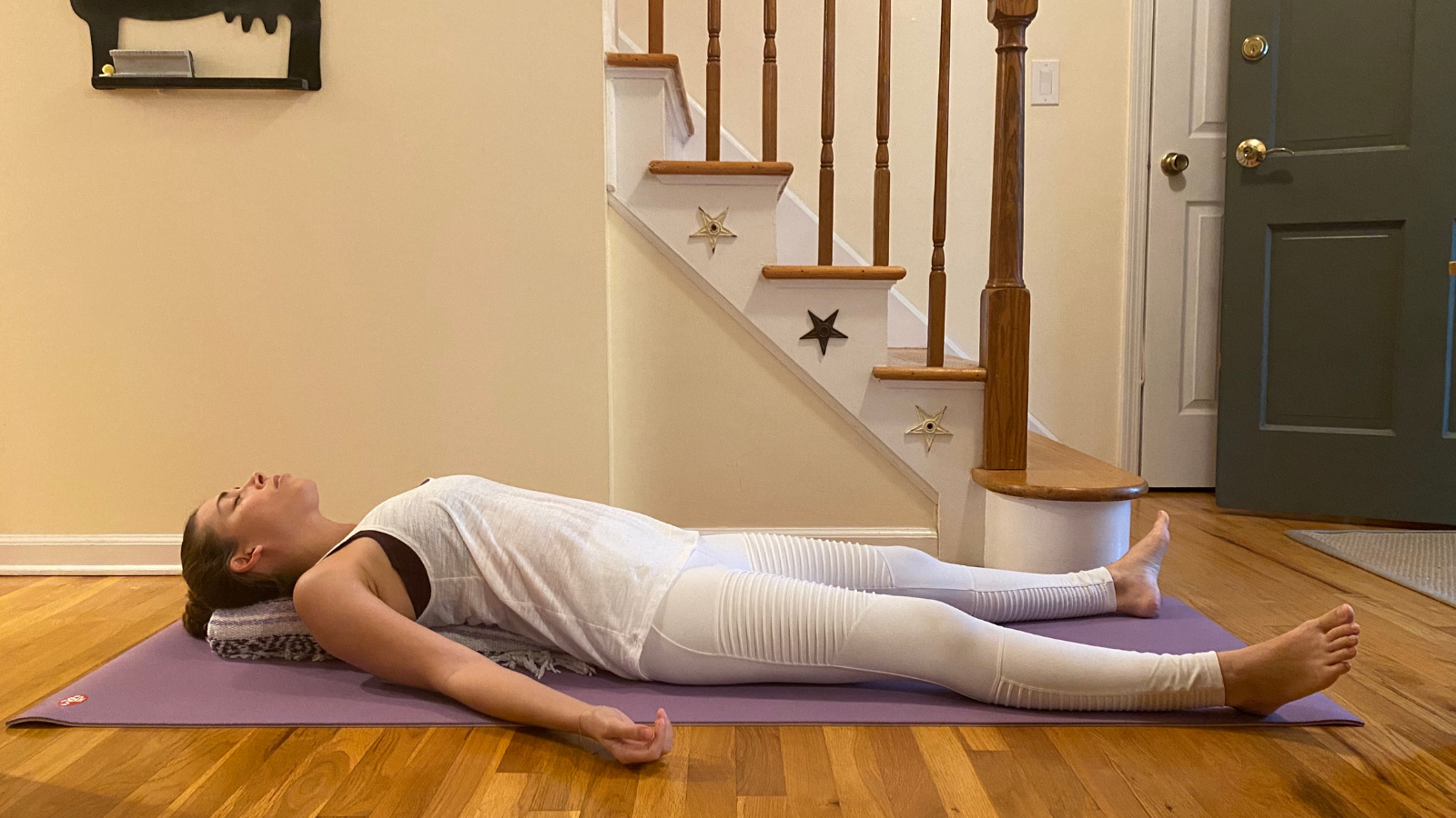 Supported Fish Pose also known as Restorative Matsyasana with only one blanket for a prop