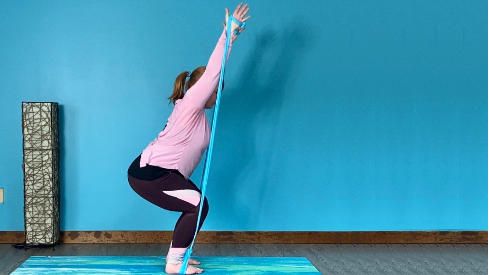 How to practice Chair Pose (Utkatasana) with therabands to bring focus to the arms