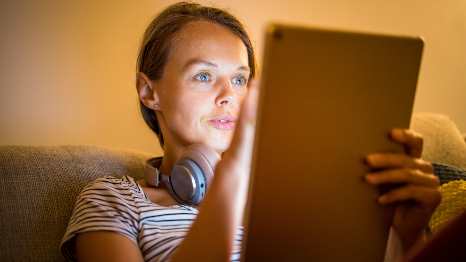 young woman staring at her ipad screen
