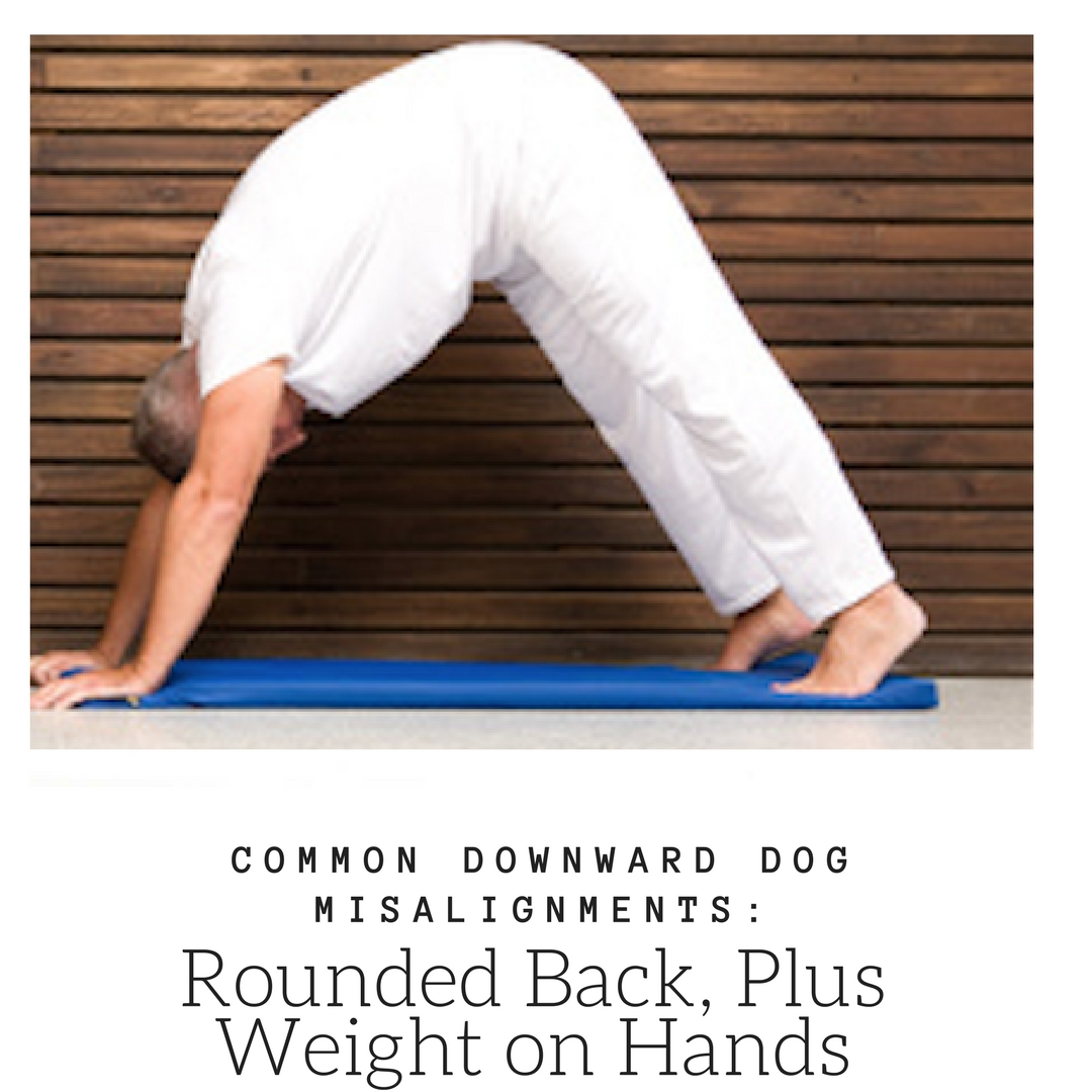 A man in downward facing dog (Adho Mukha Svanasana) in a common misalignment: rounded back, with weight on hands