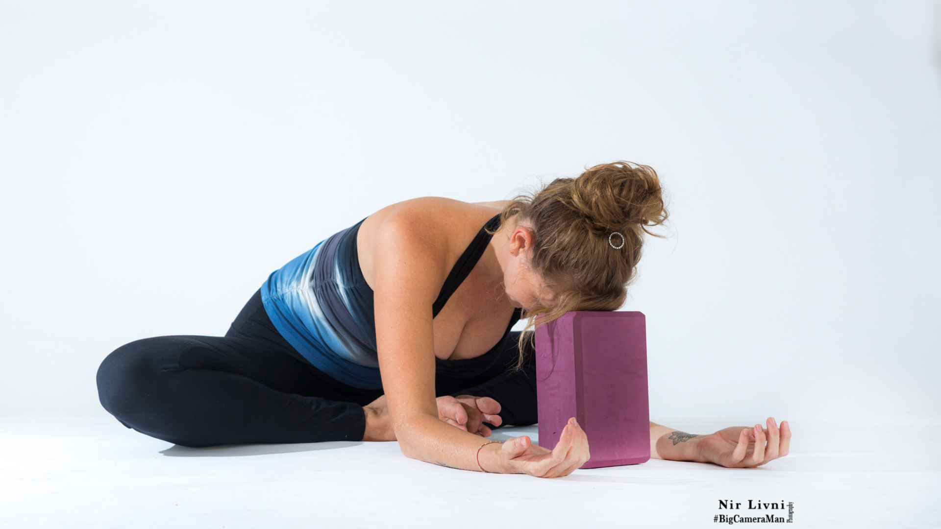 Woman practicing bound angle pose.