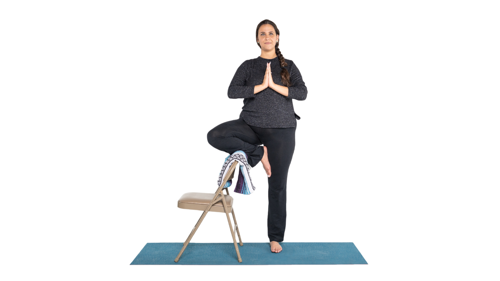 Tree Pose or Vrksasana variation using the support of a chair as a prop