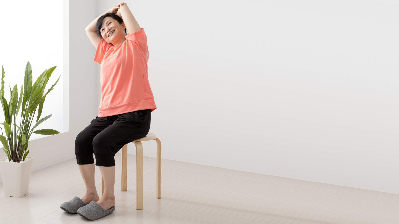 Yoga student experiencing the benefits of practicing Seated Side Bend Pose for an energy boost