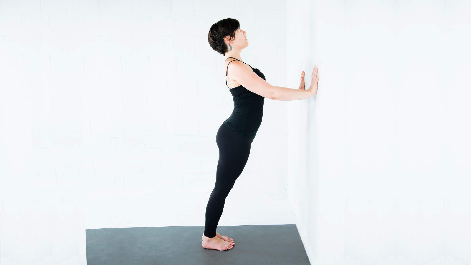 How to practice a modified version of Downward Facing Dog Pose (Adho Mukha Svanasana) at the wall