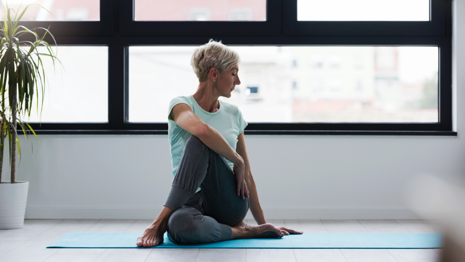 How to calm your nervous system with restorative yoga in Half Lord of the Fishes Pose