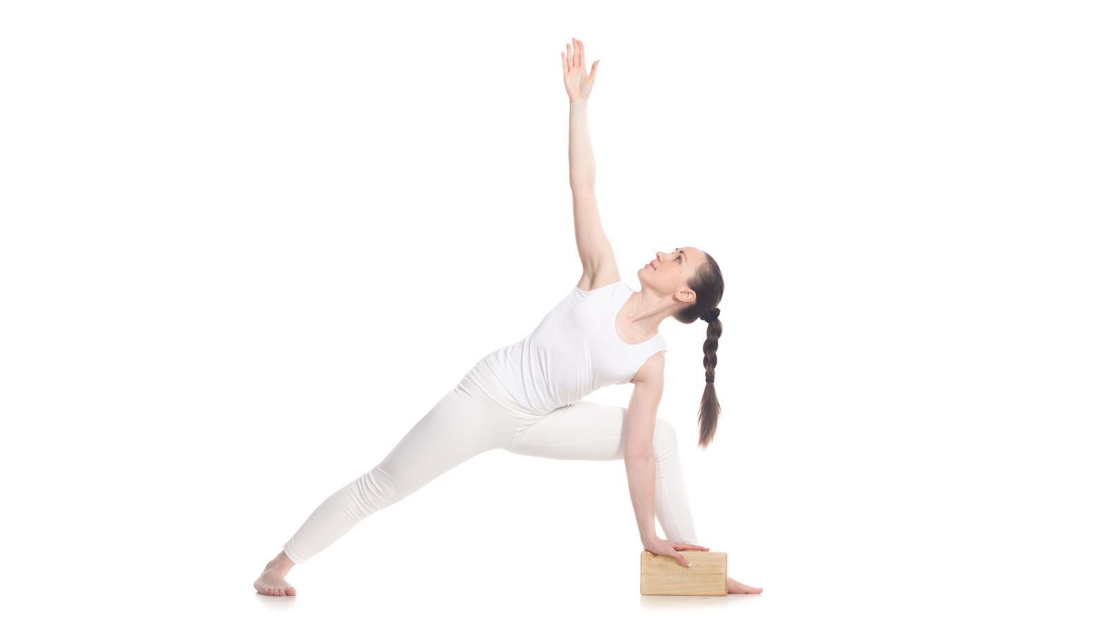 Sporty young yoga student in white sportswear doing lunge exercise for improved health, good for Kapha Dosha