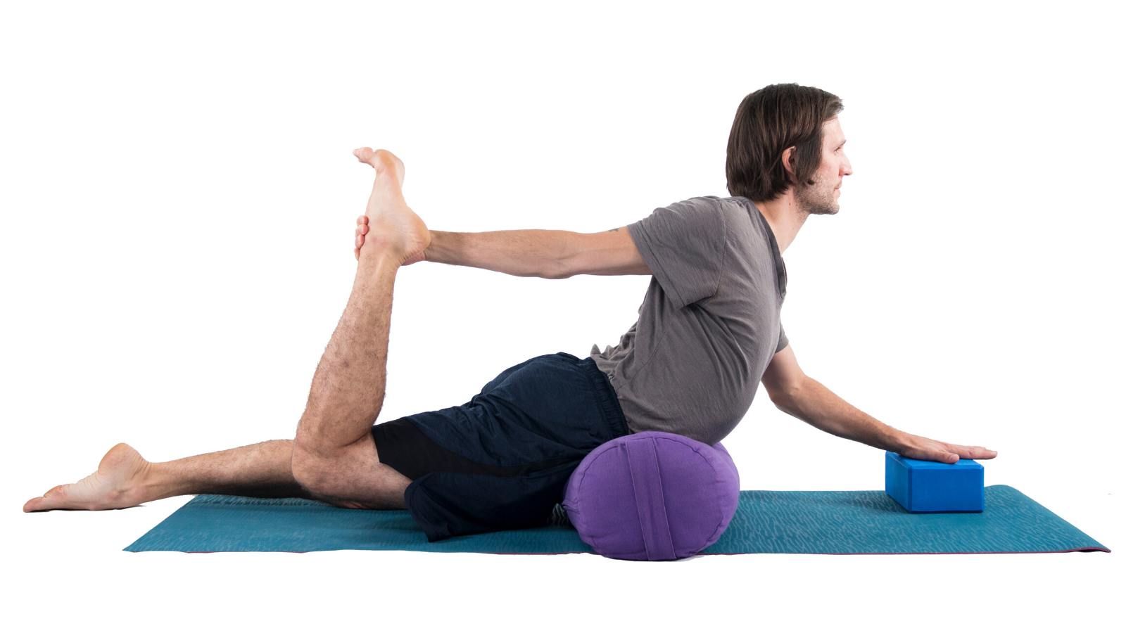 Man practicing yoga in Half Bow Pose