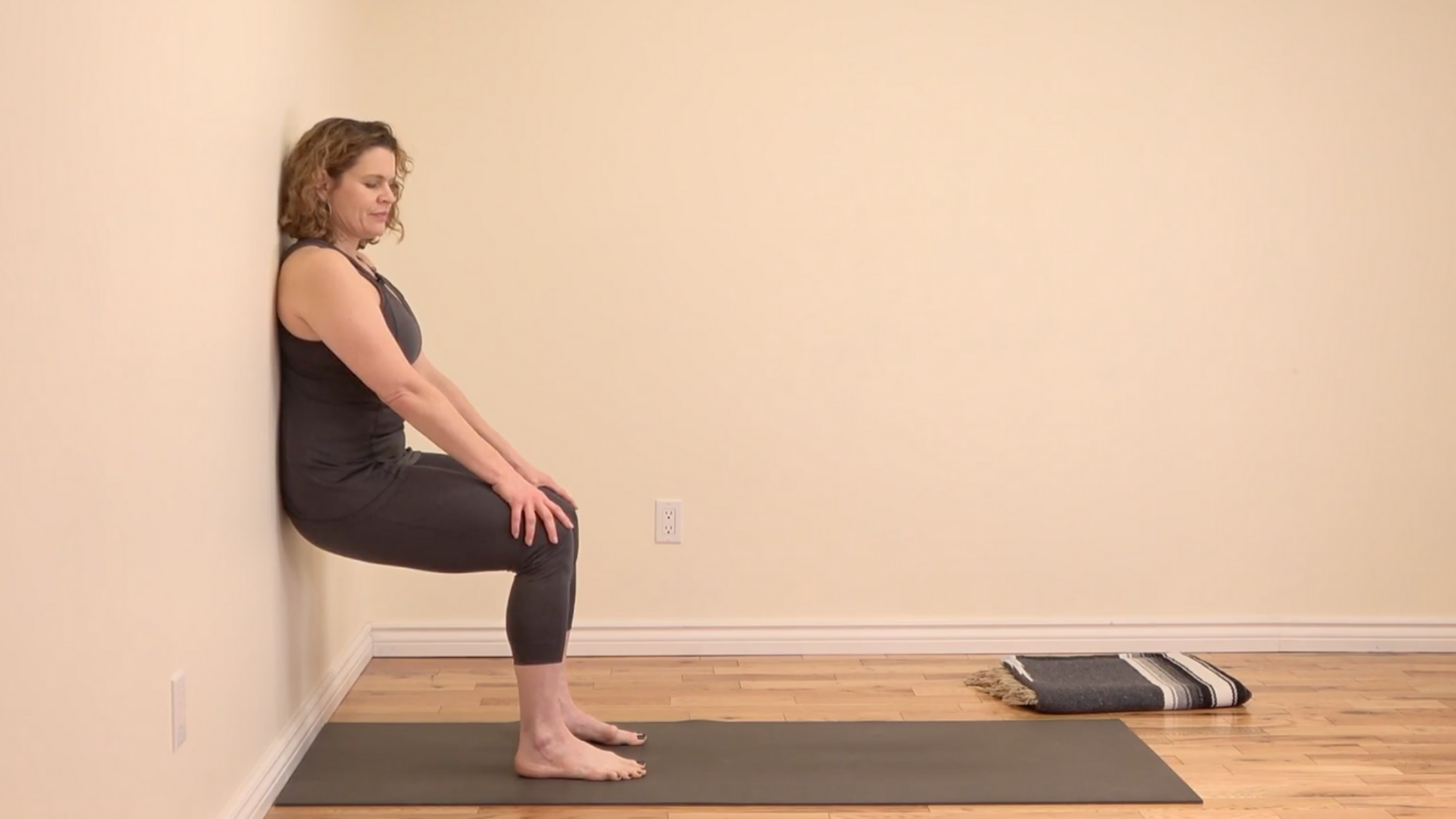 Yoga Wall Squat builds lower body strength, yoga at the wall