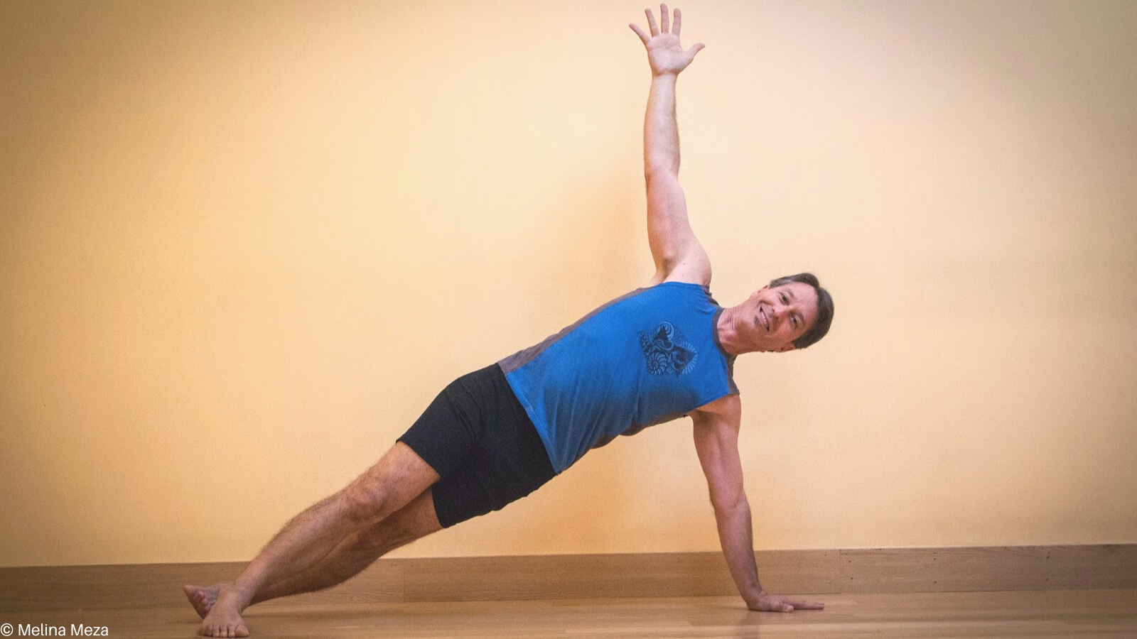 Vasisthasana or Side Plank Pose practiced with the feet separated