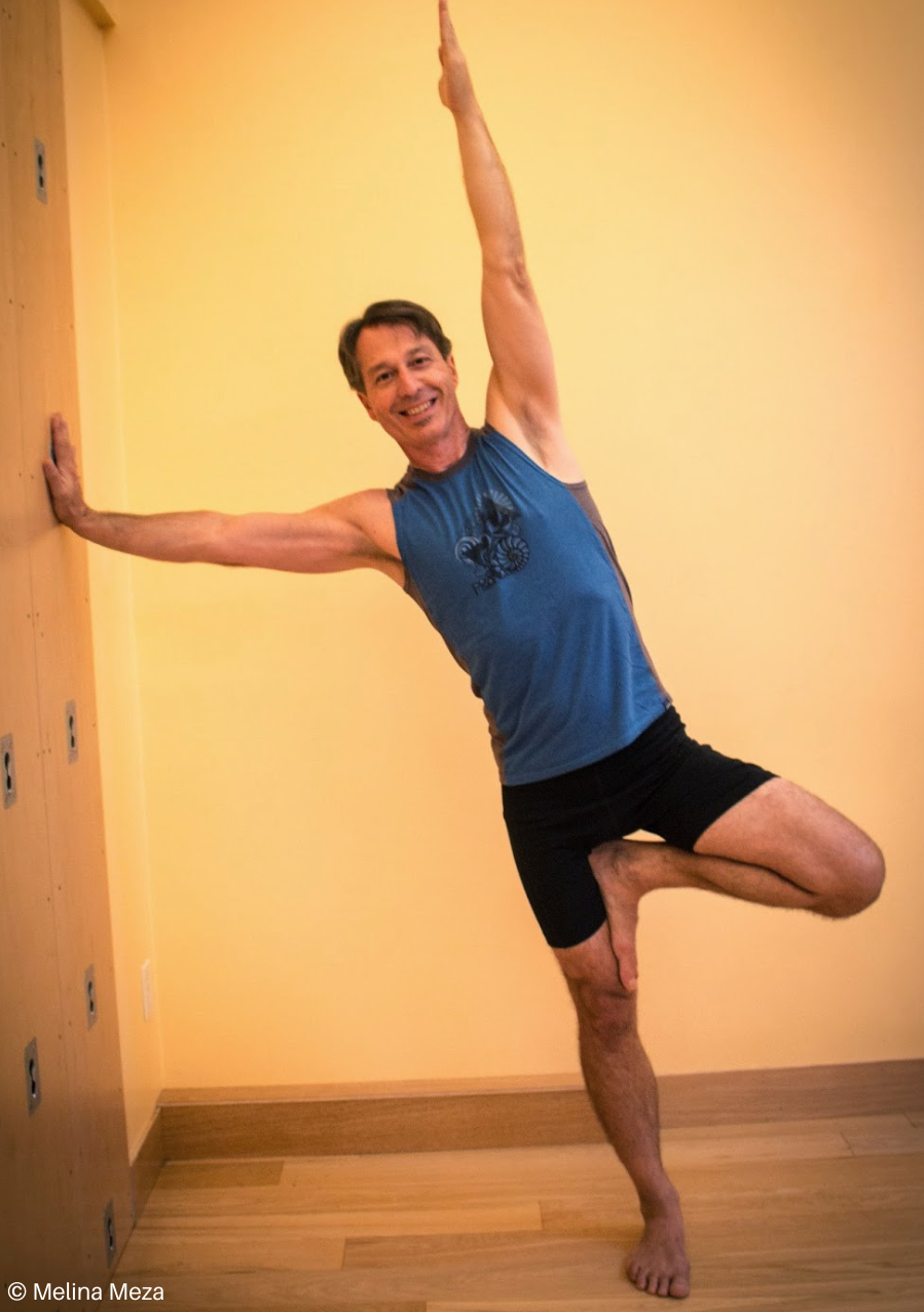 Practicing Side Plank Pose or Vasisthasana at the wall
