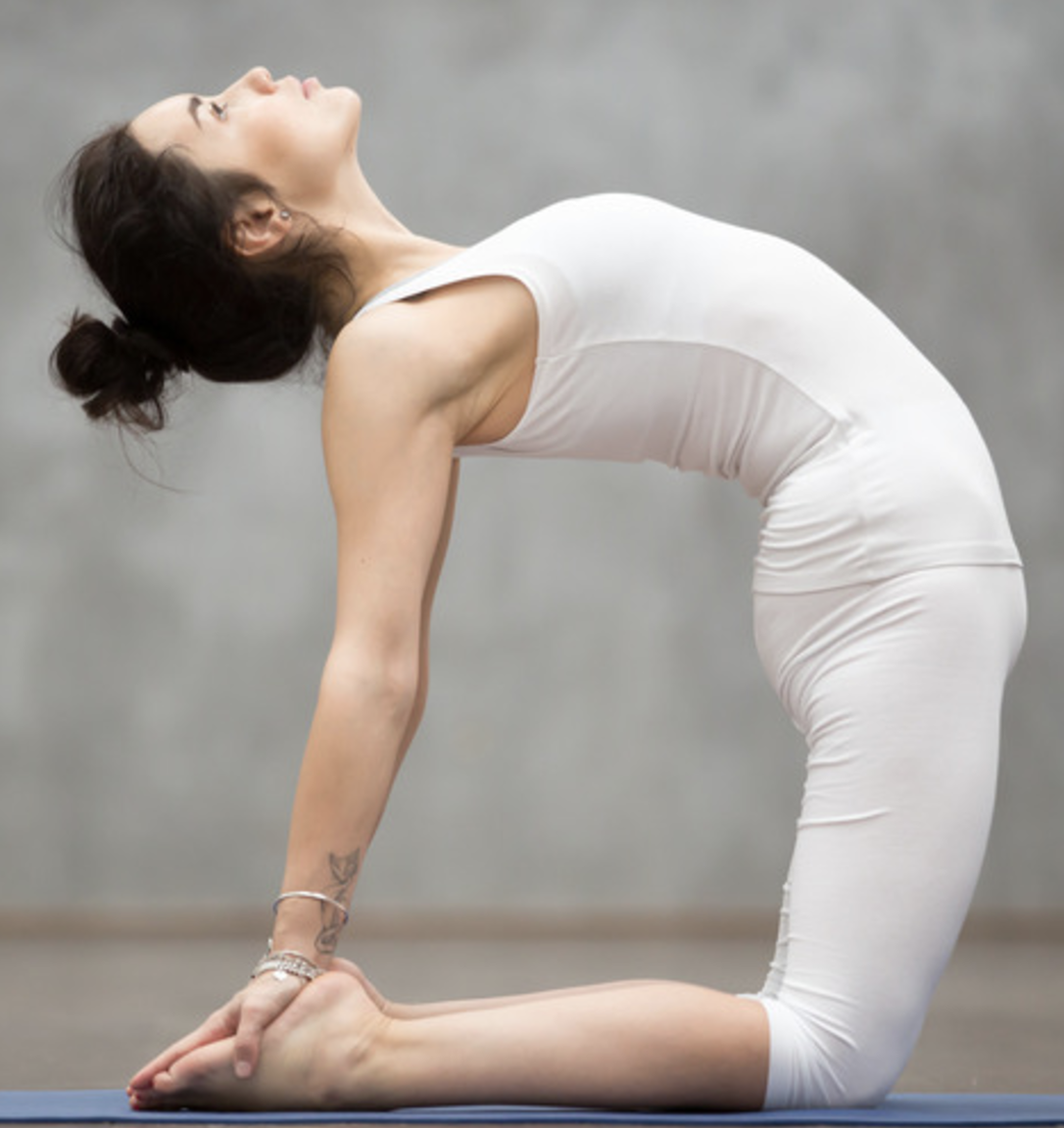 woman practicing ustrasana, camel pose