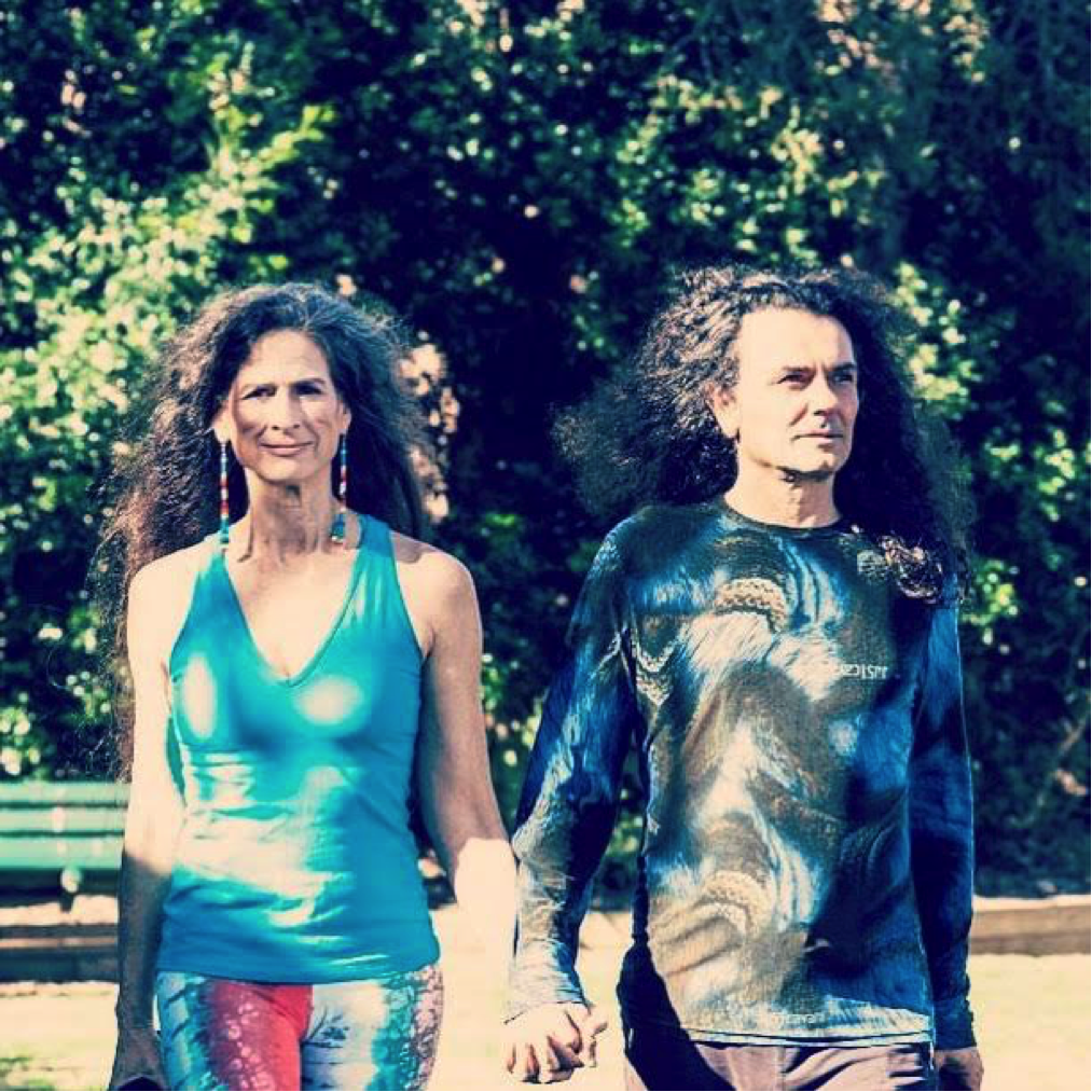 A picture of yoga teacher and medicine woman Ana Forrest, with her husband, Jose Calarco, walking and holding hands
