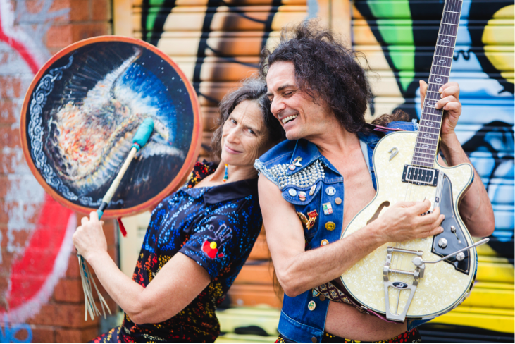 A picture of yoga teacher and medicine woman Ana Forrest, with her husband, Jose Calarco, playing musical instruments
