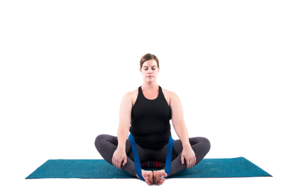 Woman practicing bound angle pose butterfly pose yoga