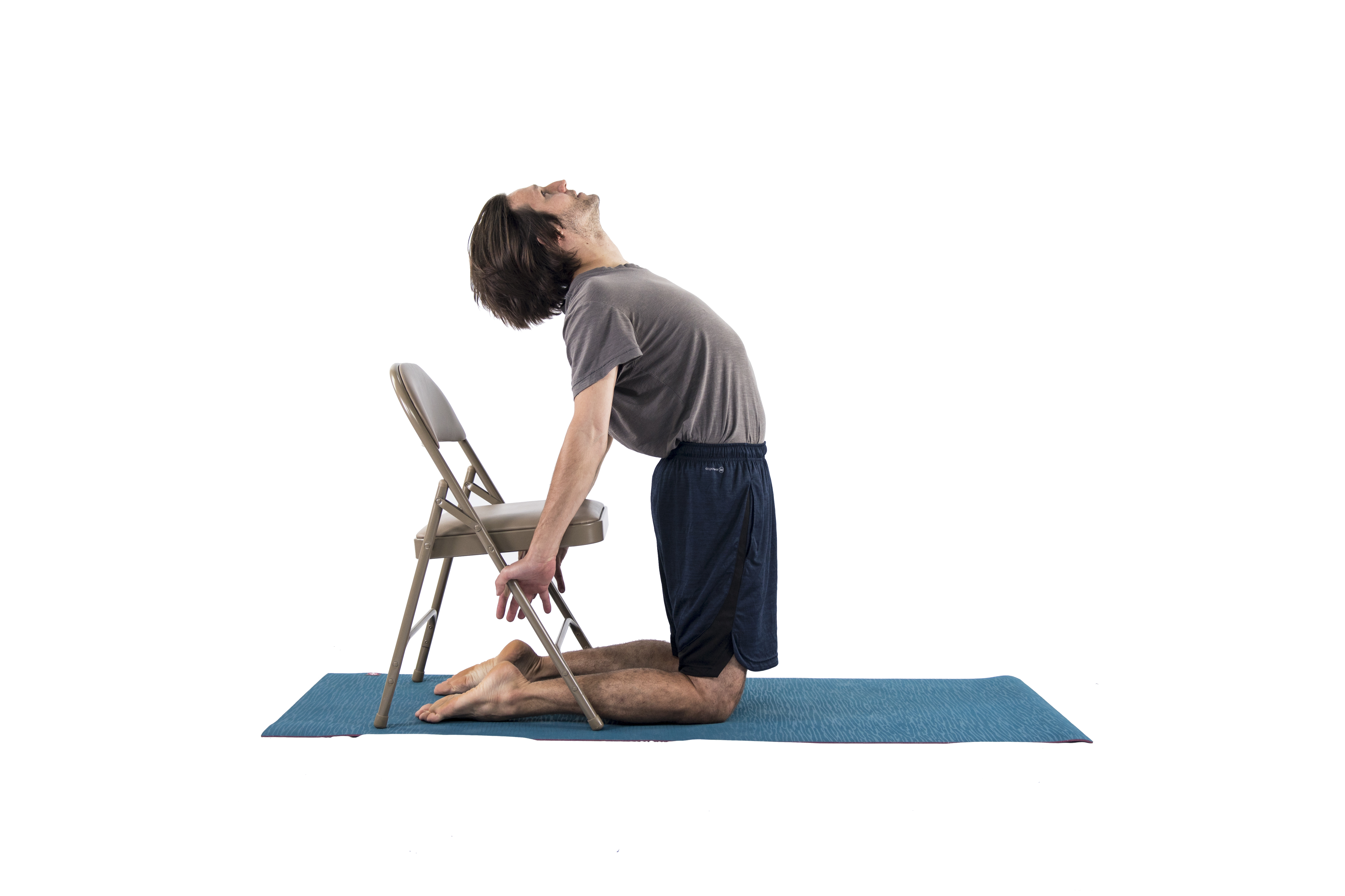 Man in Camel yoga Pose (Ustrasana) to open the chest and practice backbending in preparation for Dancer Pose