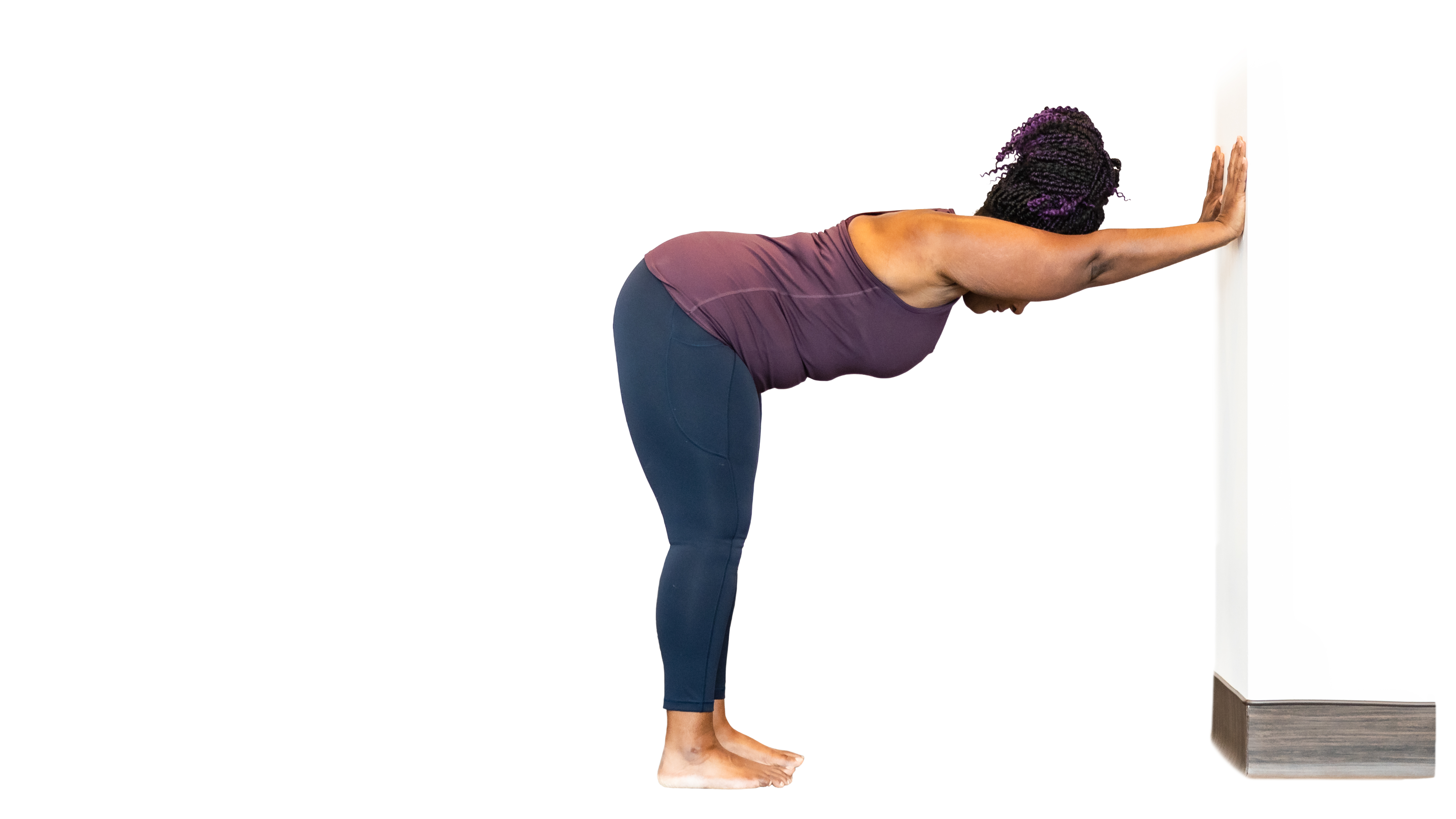 beginner yoga student practicing tips for modifying downward facing dog pose in yoga