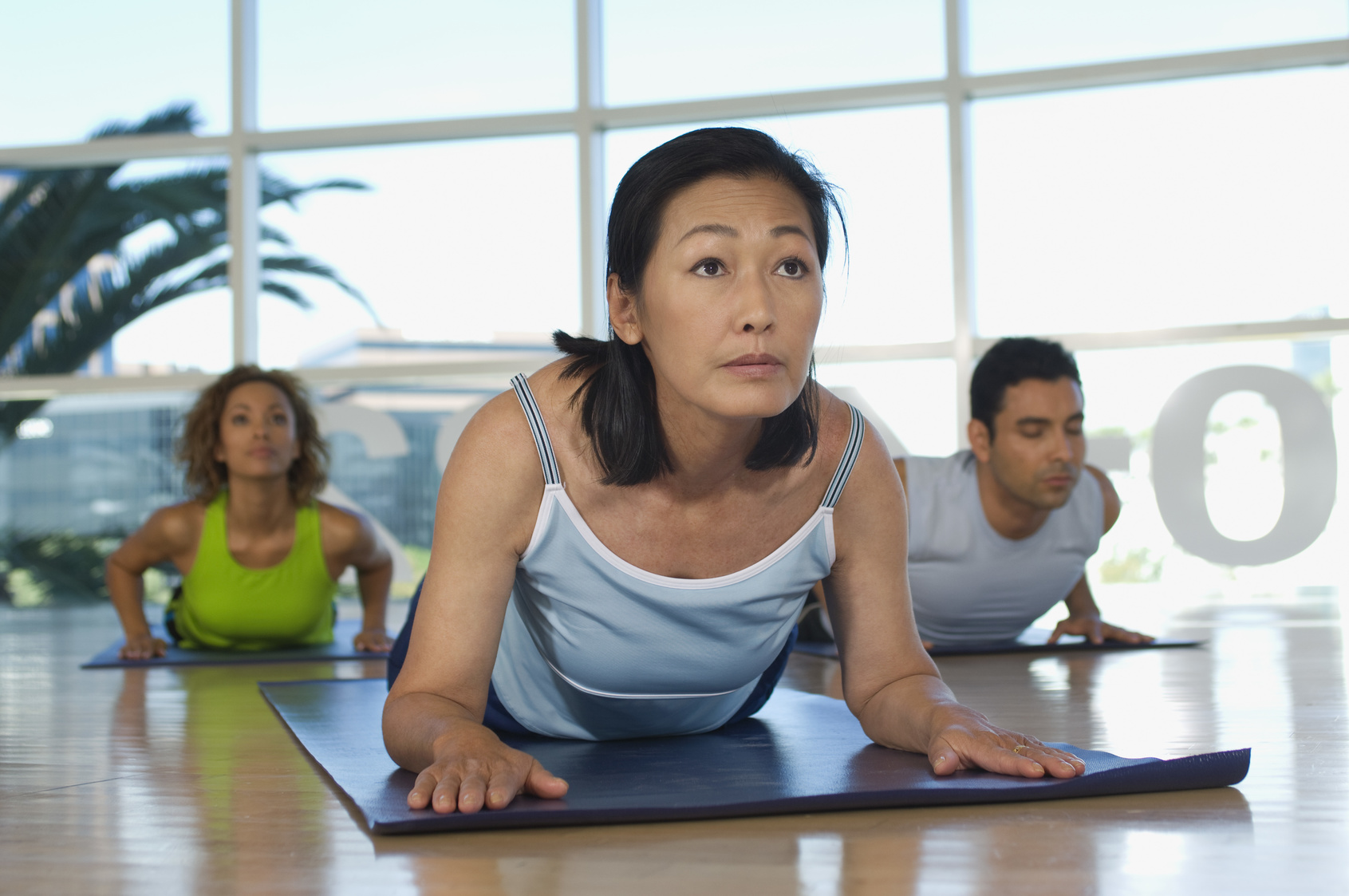 group of diverse people practicing yoga