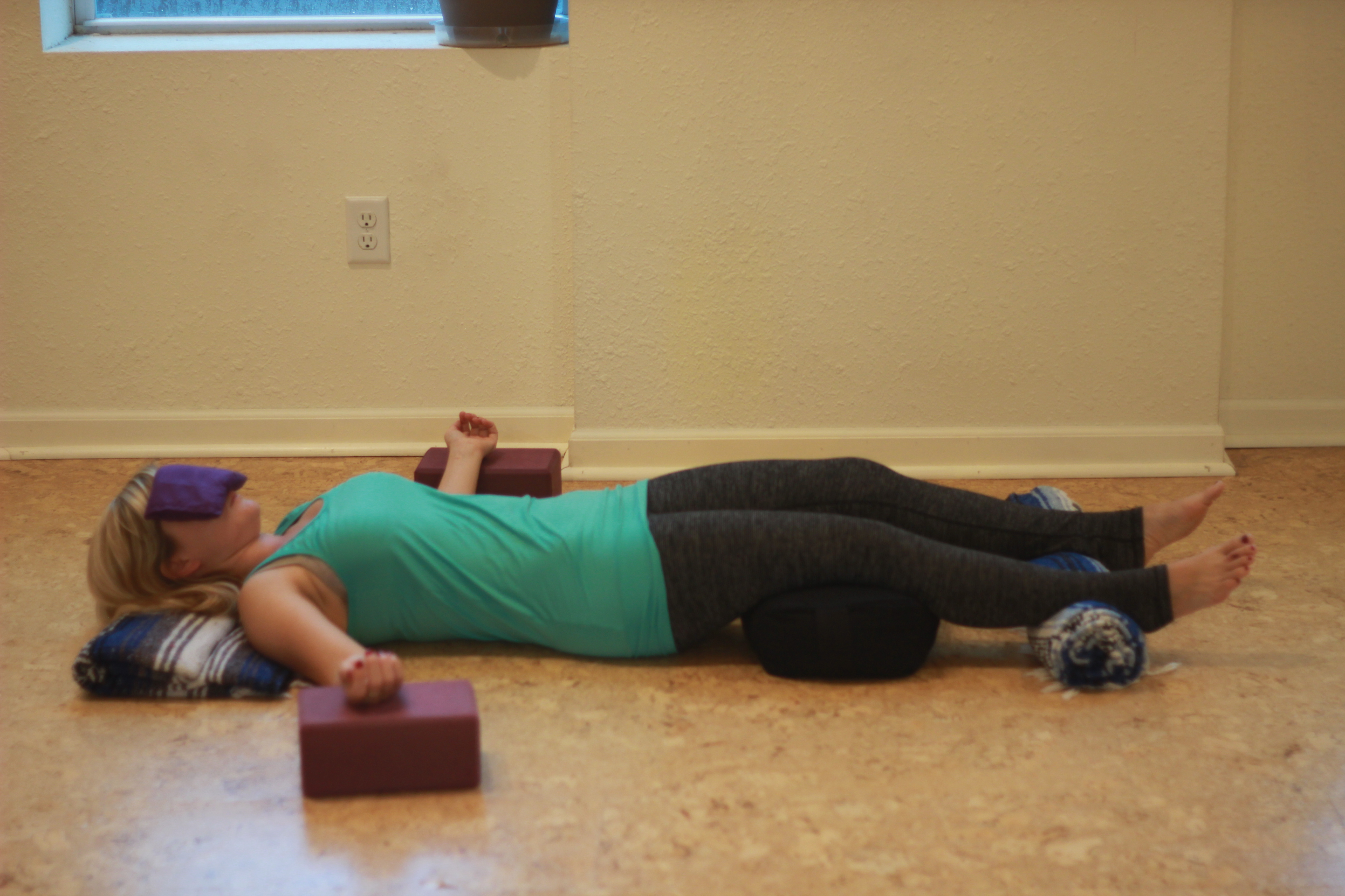 Relaxation Pose (Savasana) with props
