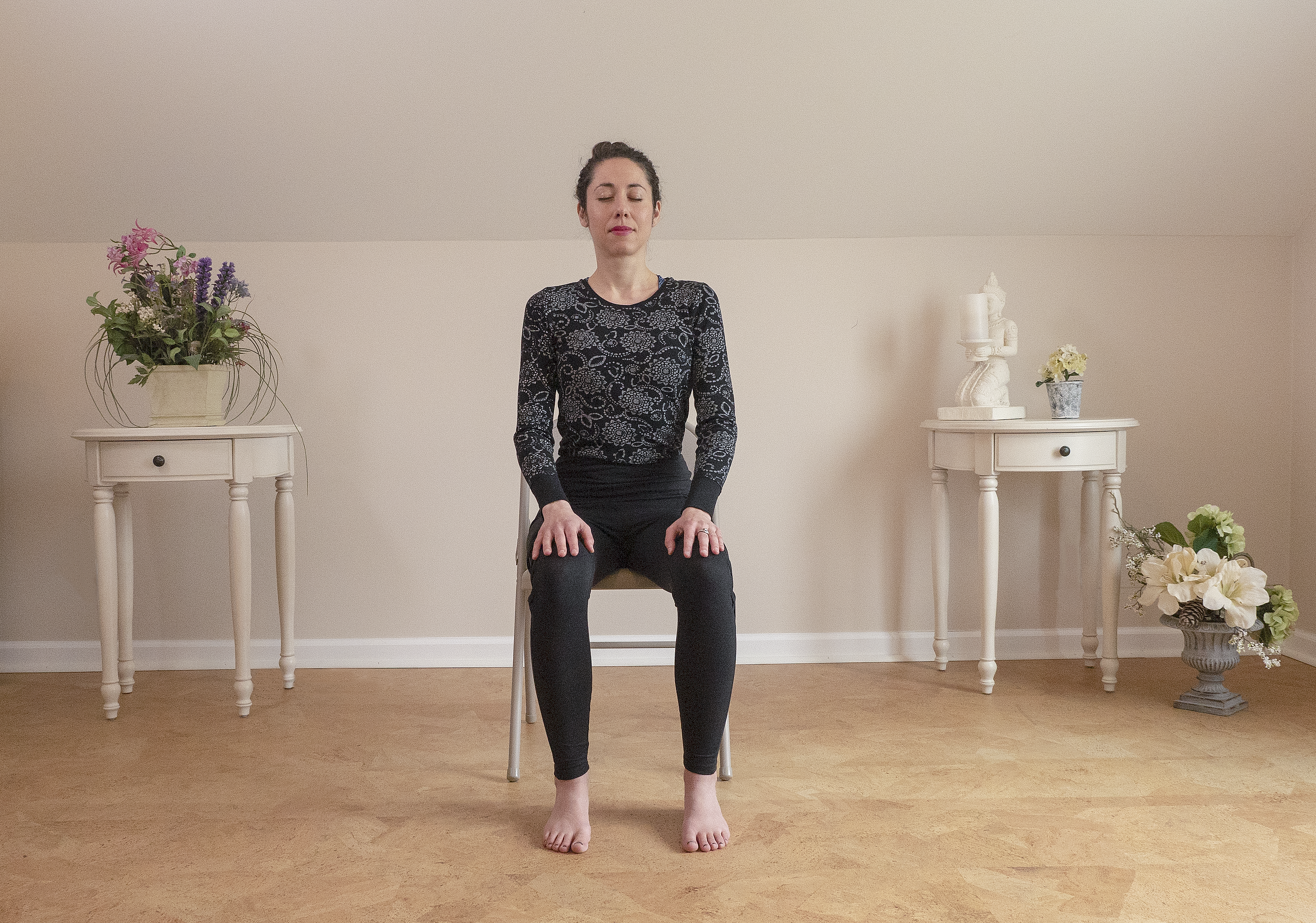 woman meditating sitting in a chair