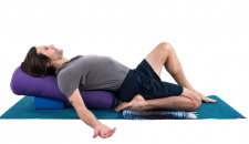 yoga man in half hero pose with props