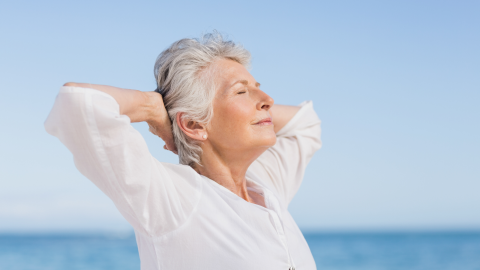 mature woman practicing yoga for spinal health